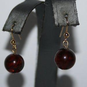 Beautiful gold dark brown amber earrings